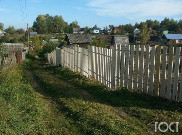 Деревянный забор в Томске